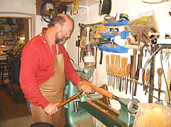 Chris McNeilly moulding a pipe on his lathe